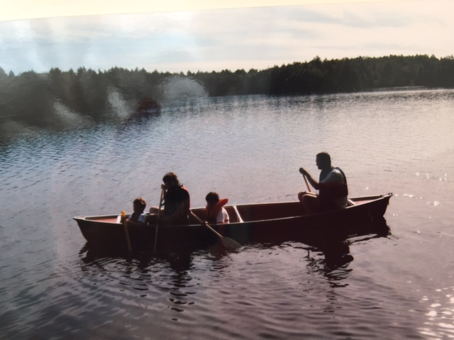 Laura canoeing with her family